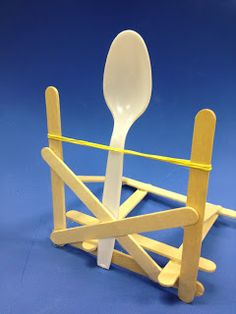 Catapult challenge: use Popsicle sticks, rubber band, plastic spoon and glue to create a working catapult
