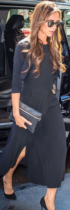 Victoria Beckham: Dress and purse – Victoria Beckham  Shoes – Casadei