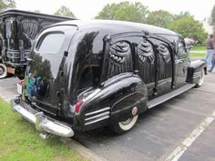 ~my neighbor has a hearse like this that he only drives on Sunday mornings to get the paper~
