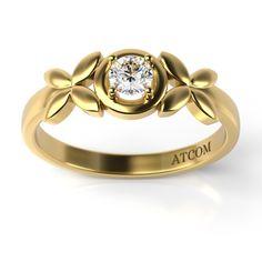 Acest inel de logodna din aur galben emana gingasie si blandete.