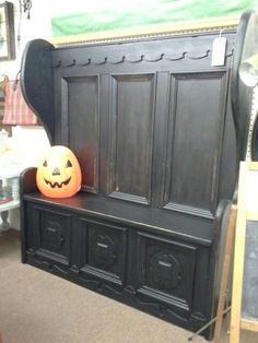SOLD - This is a vintage high back bench paint it black and lightly distressed lots of detail for an interesting look. **** In Booth C10 at Main Street Antique Mall 7260 E Main St (east of Power RD on MAIN STREET) Mesa Az 85207 **** Open 7 days a week 10:00AM-5:30PM **** Call for more information 480 924 1122 **** We Accept cash, debit, VISA, Mastercard, Discover or American
