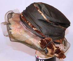 Vintage Brown Silk Voided Velvet Pink Flower Trim Wide Brim Cloche Hat It is made of a dark chocolate brown color silk fabric, with a golden brown burnout voided velvet fabric bow trim edging and pale pink silk flowers encased under the sheer brown woven horse hair brim.
