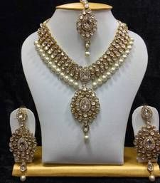 Dazzling Kundan Necklace Set. This set contains a Necklace, pair of earrings and…