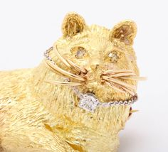 Cat Brooch Pendant with Yellow Diamond Eyes - 18k yellow gold cat brooch which can also be used as a pendant. This charming and regal looking feline has yellow diamond eyes and a diamond on his collar. $1, 750.00