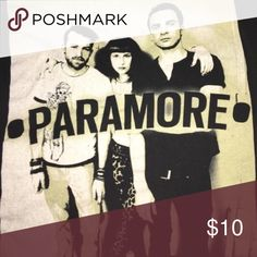 Paramore Band Tee!! Paramore band shirt with band members on the front!! Size X-Small in Men's, but CAN fit a Size Small in Girls. Only worn it ONCE. In GREAT condition!! Please make REASONABLE offers through the offer button. 💕 PLEASE keep in mind that Posh takes out fees. 😫 THANK YOU!! 😊 Kylie Cosmetics Tops Tees - Short Sleeve