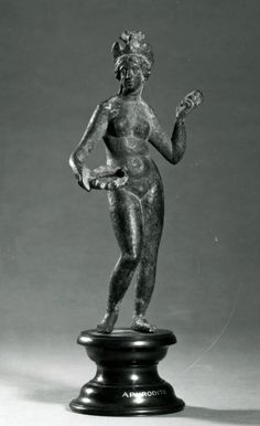 buy popular afbbe e7bf8 Bronze figure of Aphrodite wearing a dove-diadem and holding a wreath.