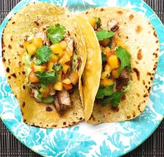 Spiced Pork Tacos with Avocado Crema and Peach Salsa  - Delish.com