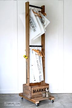 Old crate stencil storage trolley or clothes hanger for a laundry room. Displaying Funky Junk's Old Sign Stencils | funkyjunkinteriors.net