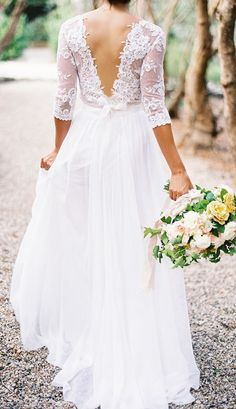 romantic flowy V back wedding dresses
