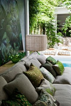 driftwood interiors: Artist Marcella Kaspar's Sydney home..grey sofas with a beautiful collection of garden greenery cushions