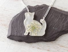 White Cat Necklace, White Flower Cat Shape Resin Pendant, Cat Jewellery, Resin Jewellery, White Jewellery, Pet Animal Jewellery, UK. 934 by JustKJewellery on Etsy https://www.etsy.com/listing/510209478/white-cat-necklace-white-flower-cat