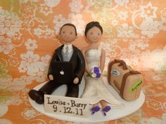 Customized Bride and Groom Seated and Travel Wedding Cake Topper.  via Etsy.