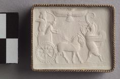 Persian King in chariot with charioteer shooting at a winged griffin. Winged disk hovering above. Cylinder seal Near Eastern, Iranian, Persian Achaemenid Period 550–331 B.C.