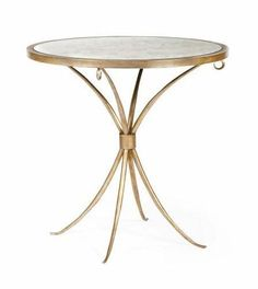With an antiqued mirror top supported by a solid iron top frame with a tubular steel base, this table stands with elegance.