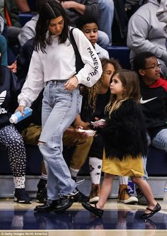 Walk this way! Also spotted commanding attention was Kourtney, who boasted her petite frame in a cosy crop top and ripped jeans