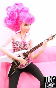 This classic Barbie 80s guitar is AMAZING in black and white! V shape with all the bells and whistles!