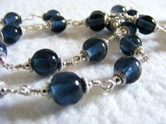 Simple design I should try.    Slate Blue Wire Wrapped Glass Jewelry Set