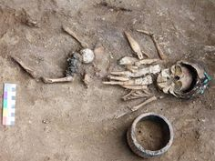 Ancient infant's grave with 'rattles' found in Russia.  This infant lived around 4,500 years ago and was buried in a birchbark cradle with  eight intricately carved figurines. The infant also wears headgear made from  11 copper plaques sewn together [Credit: Yury Esin]