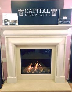 gas fire from Capital Fireplaces with a Hampton mantle in Umbrian Stone from Sovereign with Matching hearth and slips Fireplace Showroom, Showroom Ideas, Gas Fires, Hearth, Mantle, Fireplaces, The Hamptons, Stone, Home Decor