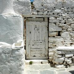 The old white door — Folegandros, Cyclades, Greece. by Didier Morlot