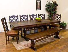 This Santa Fe Collection trestle dining table can seat eight people comfortably or ten in a pinch.  The table features inlaid slate work both on the top and along the center trestle for a unique look.
