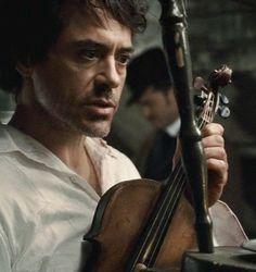 "Robert Downey Jr. creates order out of chaos as ""Sherlock Holmes"""