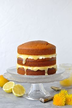 Vegan lemon curd layer cake - easy, fluffy vegan lemon cake layered with vegan lemon curd and vegan lemon buttercream, perfect for any occasion! Vegan Lemon Curd, Lemon Curd Cake, Vegan Vanilla Cake, Lemon Buttercream, Vegan Sweets, Vegan Desserts, Vegan Recipes, Vegan Food, Vegetarian Food