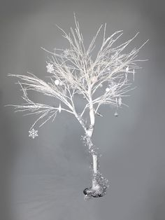 High quality White Twisted Tree with Winter Dressing available to hire. View White Twisted Tree with Winter Dressing details, dimensions and images. Twisted Tree, Prop Hire, Winter White, Winter Wonderland, Dandelion, Dressing, Party, Flowers, Image