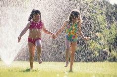 Running under the sprinkler!  Never too old!