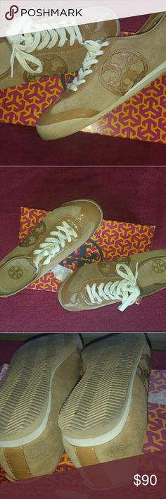 Tory Burch Sneakers Tan Tory Burch Sneakers, size 9.5, comes with box, in good condition,  worn a few times, very very comfortable,  smudge on back of shoes that can be cleaned Tory Burch Shoes Sneakers