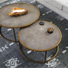 Antique brass-finished iron curves like a crescent to welcome a nesting option for its smaller-scaled companion table. A resin faux shagreen table top in grey lends rich texture to clean, modern lines. Large Table Dims: x x Small Table Dims: x x Large Coffee Tables, Brass Coffee Table, Diy Coffee Table, Decorating Coffee Tables, Coffee Table Design, Coffee Ideas, Nesting Coffee Table, Coffee Room, Large Table