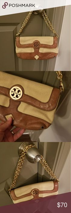 Tory Burch purse Very cute purse.  Has small hole on the side as shown in the picture. Tory Burch Bags