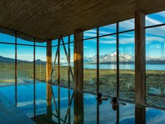 This 40-room lodge is an hour from Puerto Natales, set amid a big-sky landscape with uninterrupted views of the Torres del Paine massif. In the principal salon, a wall of glass draws the eye across Lake Sarmiento to the serried peaks beyond. Ample guest rooms are smartly outfitted in a soothing natural palette of wood, wool, and leather