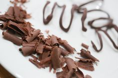 Make chocolate curls to add a gourmet touch to desserts. You can add a few as a garnish, or decorate with different colors and sizes to embellish homemade or store bought treats. Melt the chocolate. Pour approximately one cup of water into...