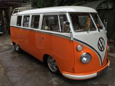orange splitty right hand drive vw bus ♠ re-pinned by  http://www.wfpblogs.com/author/thomas/