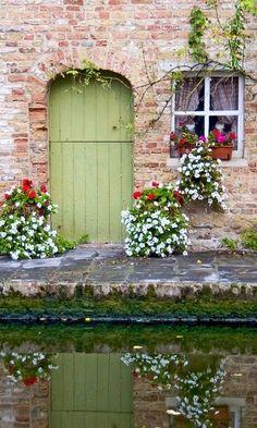 Canal Doorway - The sweetest canal scene ever; Brugge, Belgium. #Belgium #travel
