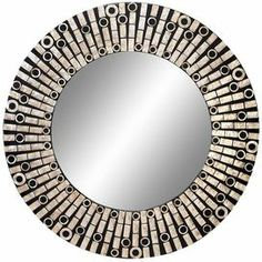 """Wood wall mirror in black with capiz shell accents. Product: Wall mirror   Construction Material: Capiz shell, wood and mirrored glass    Color:   Cream and black    Dimensions: 31"""" Diameter"""