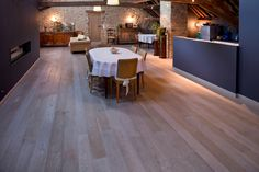 Chêne de l'est French Oak Wood Floors.  Available in a variety of surface treatments, widths of planks and colors.  www.RugsAndCarpets.com