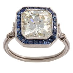 wow.  French 1900's, 3.5ct cushion cut diamond with sapphires set in platinum.