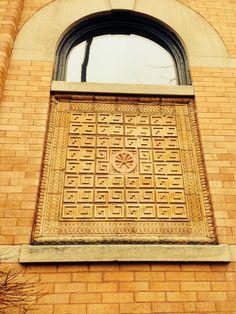 Bricked pattern boarding up old window