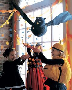 Fun DIY flying bat pinata for Halloween decor + activities | tutorial at Martha Stewart