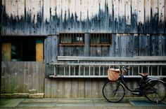 Photo of the Day: A Decaying Facade in Japan |A bicycle is parked in front of a textured, wooden facade on the street in Shiga, #Japan on January 5, 2015. (VisualAge/Flickr)