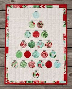 """It's Christmas in July ! Here is a forest of free patterns and tutorials for Christmas Tree quilts and wall hangings. Quilted trees are """"green"""" (reusable) and they take up far less space than a rea"""