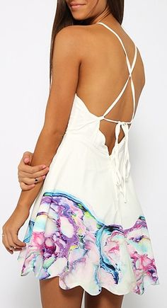 Beautiful color in this spaghetti strap backless floral print dress