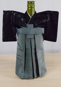 Handmade Men's Kimono and hakama pants wine bottle cover. Made from authentic vintage Japanese kimono and hakama pants.