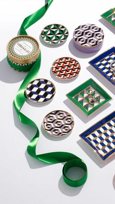 Geometric motifs with gobs of gold adorn the Jonathan Adler  high-fired Versailles collection. Packaged in nifty gift boxes, they make a perfect hostess present (or pick-me-up for yourself).