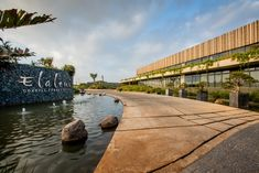 Image 7 of 21 from gallery of The Gates / Bloc Architects. Photograph by Chris Allan Gates, Meaning Of Community, Kwazulu Natal, Outside World, Sustainable Living, Water Features, Lighting Design, Natural Stones, Entrance