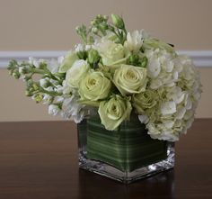 Bar centerpiece for Spring soiree, lots of white and greens: stock, roses, hydrangeas, lisianthus, hypericum, freesia.