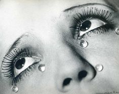 SURREALISM LECTURE Man Ray - Glass Tears, 1932 This image here displays a Surrealist element through the dreamlike characteristics of the photo. The hyperbolic spherical glass tears under the eye heighten the emotion of the image.