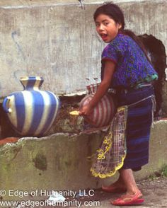 This travel photography essay depicts water handling in a way the most people in developed countries never had to endure.  The young girl from Guatemala is collecting water in a jug from a c...